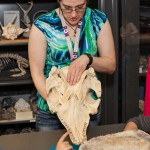 Julie M Tome, YorkU Astronomy Alumna with a dinosaur skull