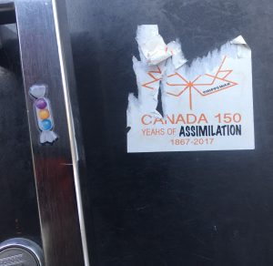Sticker on the north doors of Central Square, York University, Keele Campus