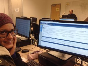 Melissa Peretta learns about editing & creating Wikipedia pages from John Dupuis (background) in a January 2014 Plant Ecology course lab.